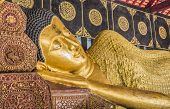 foto of recliner  - Reclining Buddha gold statue in temple of Thailand - JPG