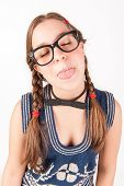 picture of goofy  - Young nerdy and goofy girl sticking out her tongue - JPG