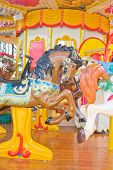 stock photo of riding-crop  - Carousel horse on a traditional fun fair ride.