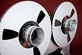 stock photo of analogy  - Analog Stereo Open Reel Tape Deck Recorder Spool Closeup - JPG