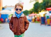stock photo of outerwear  - stylish kid walking city street autumn fashion - JPG