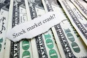 picture of stock market crash  - Stock Market Crash newspaper scrap on assorted money - JPG
