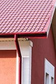 foto of downspouts  - House roof gutters and downspout on the corner of a house - JPG