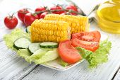 picture of corn cob close-up  - Grilled corn cobs on table - JPG