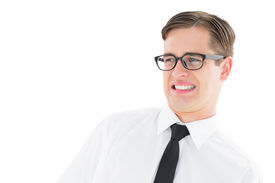pic of disgusting  - Geeky young hipster looking with disgust on white background - JPG