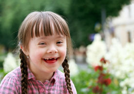 stock photo of playgroup  - Portrait of beautiful young girl smiling  - JPG