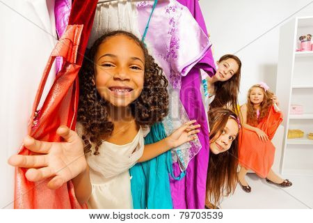 Diversity of girls during shopping choose clothes