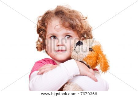 Pretty Girl Hugging Toy Dog