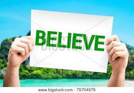 Believe card with a beach on background