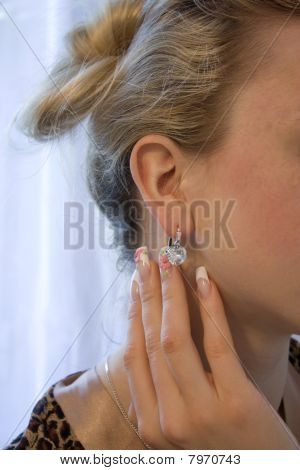 Woman's ear with diamond jewelry