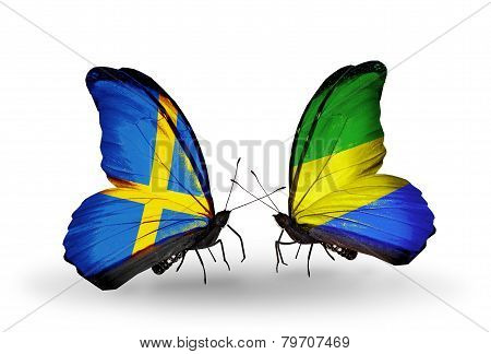 Two Butterflies With Flags On Wings As Symbol Of Relations Sweden And Gabon
