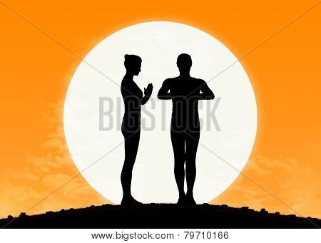 Man And Woman Practicing Yoga At Sunrise