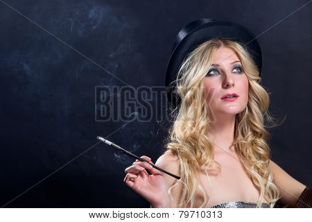Lady in Black Hat smokes a long slim cigarette
