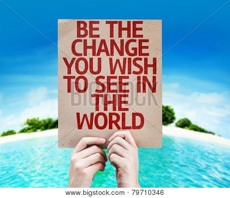 Be The Change You Wish to See in the World card with a beach on background