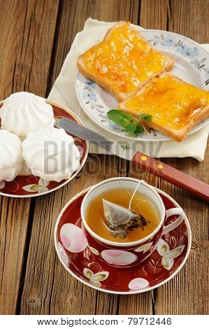 Green Tea, Zefir And Toasts With Orange Marmalade On Wooden Background