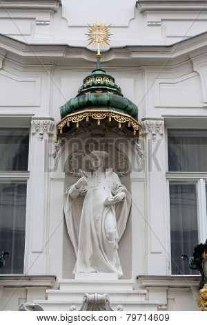 VIENNA, AUSTRIA - OCTOBER 10: Saint Charles Borromeo, detail from the house of the Knights of the Cross with the Red Star on October 10, 2014 in Vienna. The Knights ware a religious order from Bohemia
