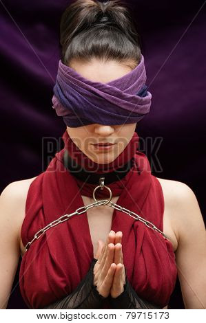 Blindfolded Girl Pray Violet Blanket Background