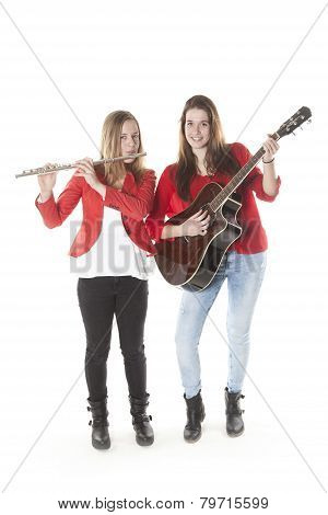 Two Teenage Sisters Play Flute And Guitar In Studio
