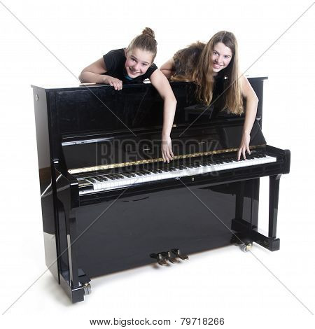 Two Teenage Girls And Black Upright Piano