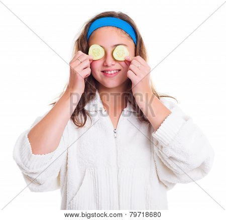 Girl With Cucumber Slices Over Her Eyes