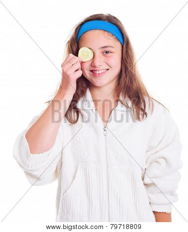 Girl With Cucumber Slice Over Her Eye