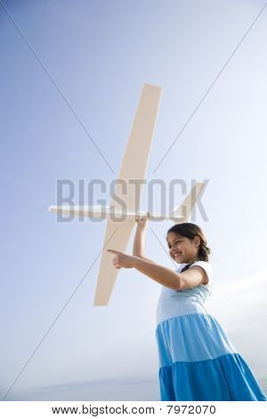 Pretty Girl Playing With Toy Glider