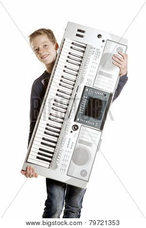 Teenage Boy Carries Keyboard In Studio