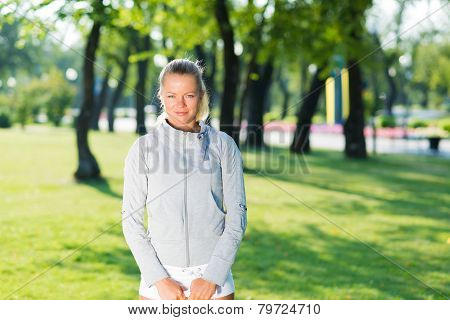 young woman in a tracksuit