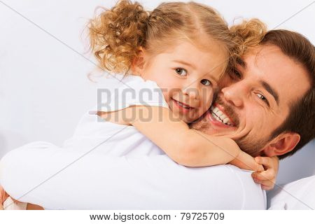Portrait of smiling father and cute daughter