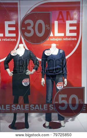 Sale In Shopping Window Of Fashion Store