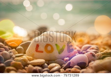 Stone with LOVE text on Sea Background