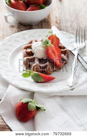 Belgian waffles with vanilla ice cream and strawberries
