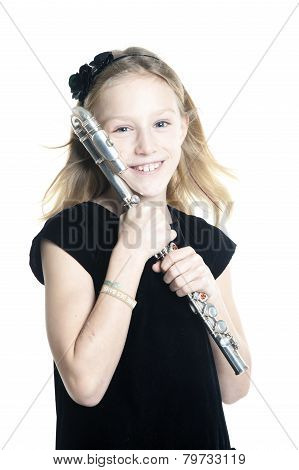Young Smiling Blond Girl Holds Flute In Studio