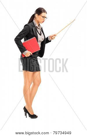 Full length portrait of an angry female teacher swinging with a stick isolated on white background