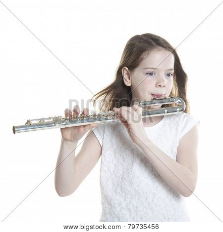 Young Girl With Brown Hair Holds Flute In Studio