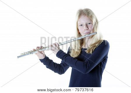 Young Blond Girl Playing Flute In Studio