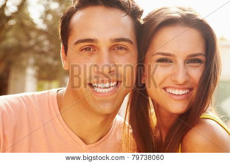 Head And Shoulders Portrait Of Couple On Holiday