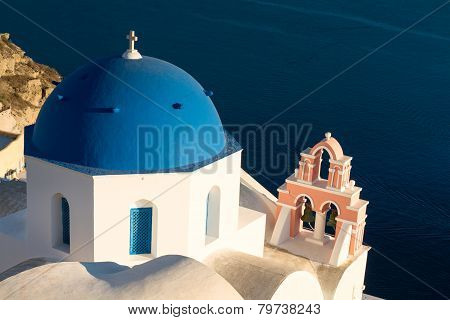 Blue Dome Of A Church In Oia In The Evening Light