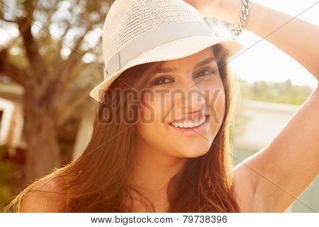 Head And Shoulders Portrait Of Woman Wearing Hat