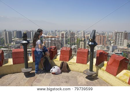 Young couple enjoy the view of Santiago, Santiago city, Chile.