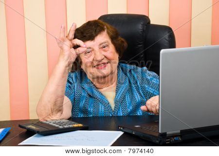 Cheerful Elderly Executive Showing Okay Sign Hand