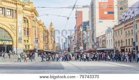 Busy crosswalk outside Flinders Street Station in Melbourne