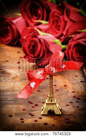 Valentine's Setting With Eiffel Tower Decoration And Bouquet Of Red Roses