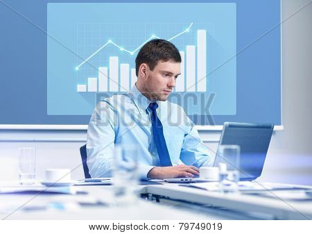 business, people and work concept - businessman with laptop computer and growth chart on virtual screen in office