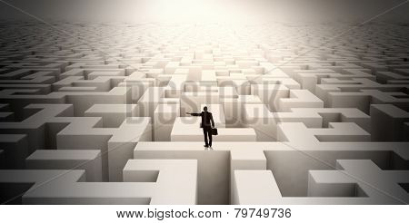 Puzzled businessman standing on top of labyrinth