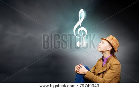 Young pretty woman and sign of music clef
