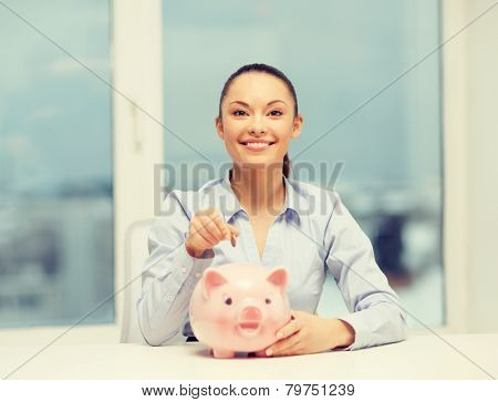 banking and finances concept - lovely woman with piggy bank and cash money