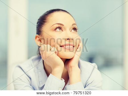 business and office concept - smiling businesswoman dreaming in office
