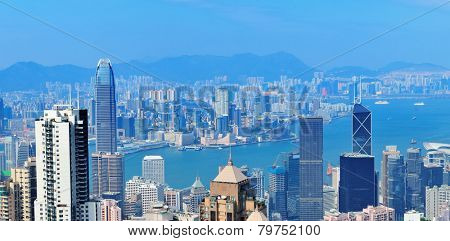 Victoria Harbor aerial view with Hong Kong skyline and urban skyscrapers in the day.