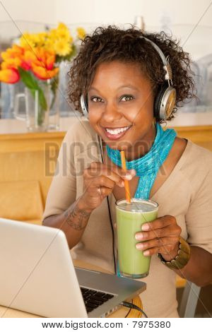 Woman With Laptop And Smoothie
